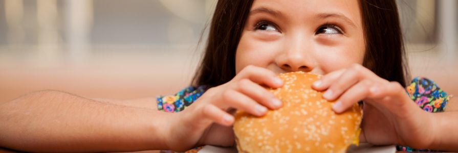 Kid eating burger.jpg