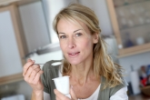 Woman eating yogurt.jpg