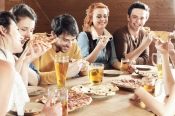 Friends eating pizza and drinking beer.jpg
