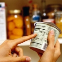 migranes-food-triggers-gallery-woman-examining-food-label-320.jpg